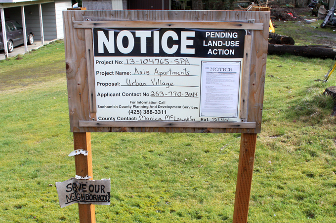 "Land use sign and ""Save Our Neighborhood"" sign previously at the Axis Apartments site"
